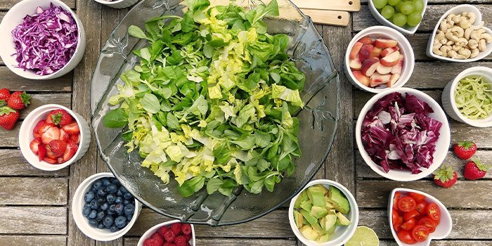 salad fruits and vegetables in bowls